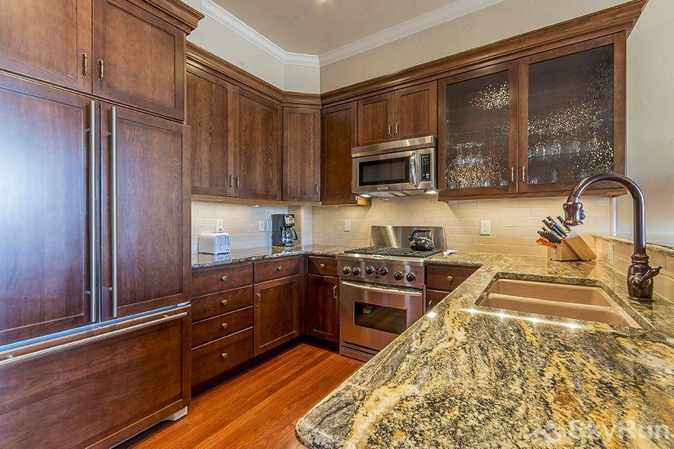 The Victoria 4 All of the kitchen cabinets are made of mahogany.