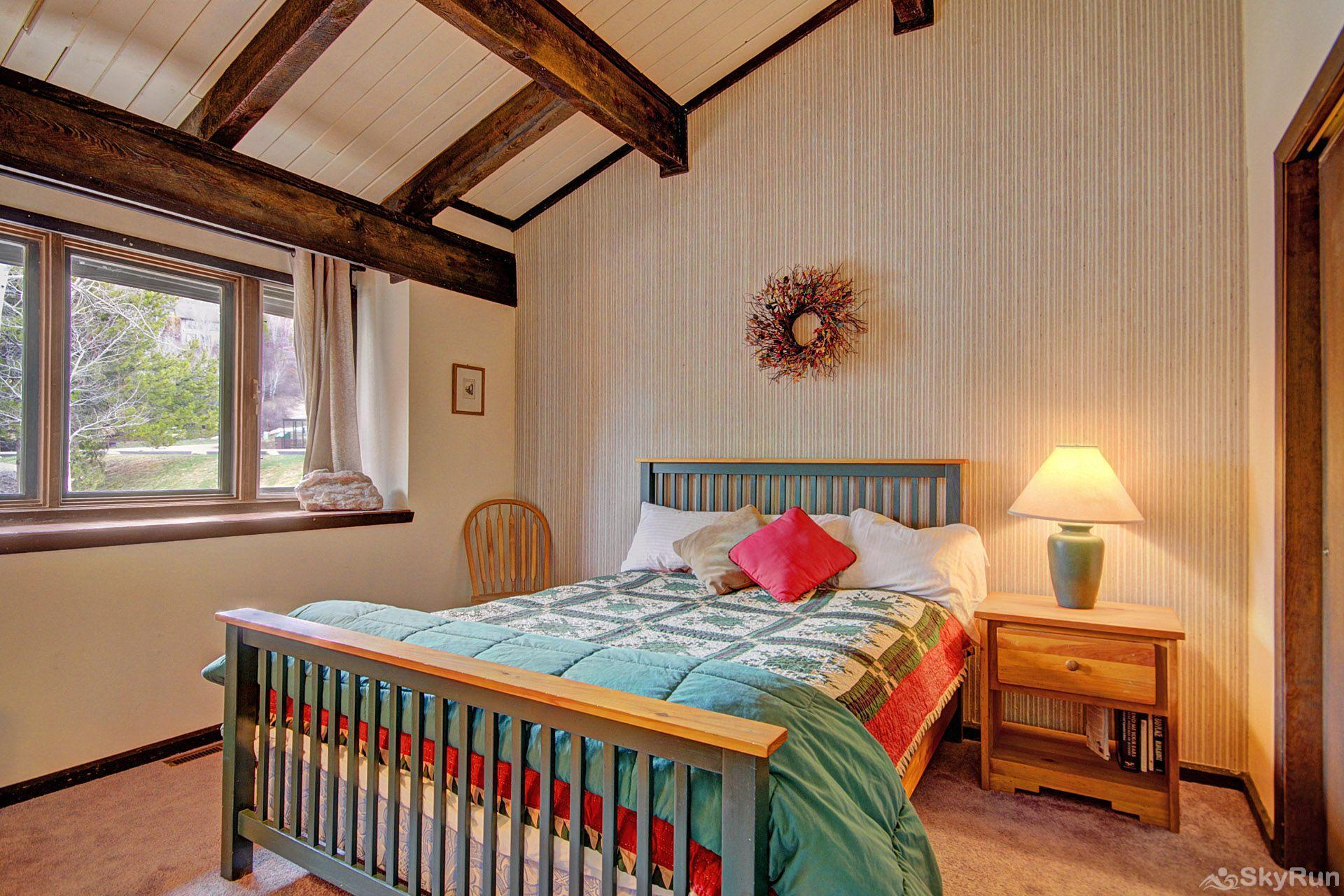 Herbage Townhomes E1 You will love the beautiful wooden beams in the guest room.