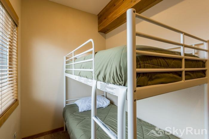 Waterford 10 The bunk room has 2 twin bunk beds and storage drawers under the beds.