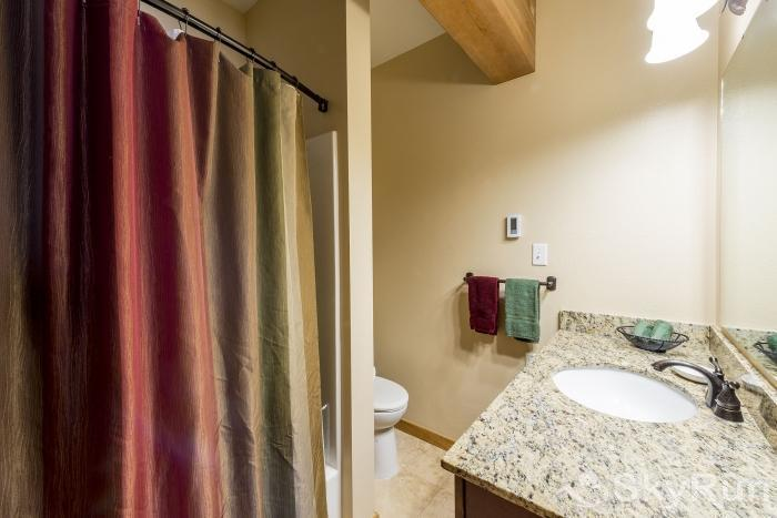 Waterford 10 The master bathroom has heated floors, 2 sinks, and granite countertops.